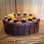 Торта с тъмен шоколад и кандирани портокали